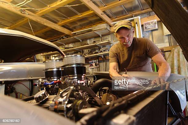 mechanic working in garage shop - vintage car stock pictures, royalty-free photos & images