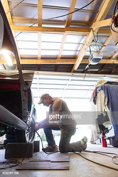 Mechanic working in garage shop