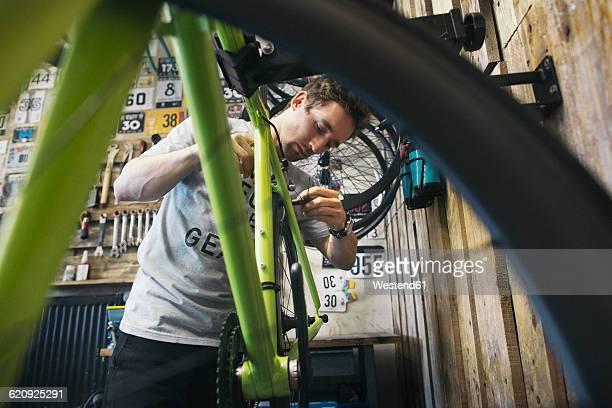 Mechanic working on bicycle