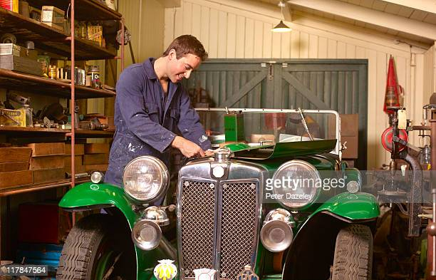 mechanic working on classic car - vintage auto repair stock pictures, royalty-free photos & images