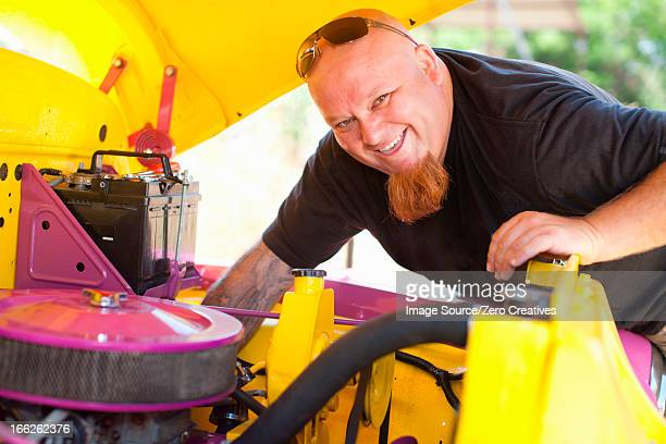 Mechanic working on colorful car