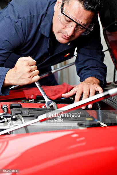 mechanic working on engine compartment