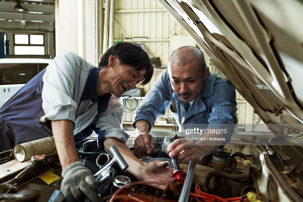Mechanic Working Sincerely At A Japanese Automobile Repair ...