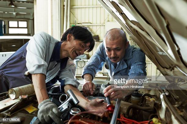 mechanic working sincerely at a Japanese automobile repair shop