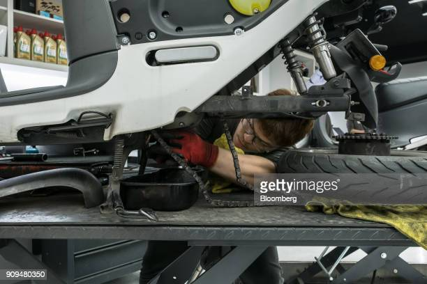 A mechanic works on a Gogoro Inc scooter at one of the company's stores in Taipei Taiwan on Monday Jan 22 2018 Gogoro the Taiwanese...