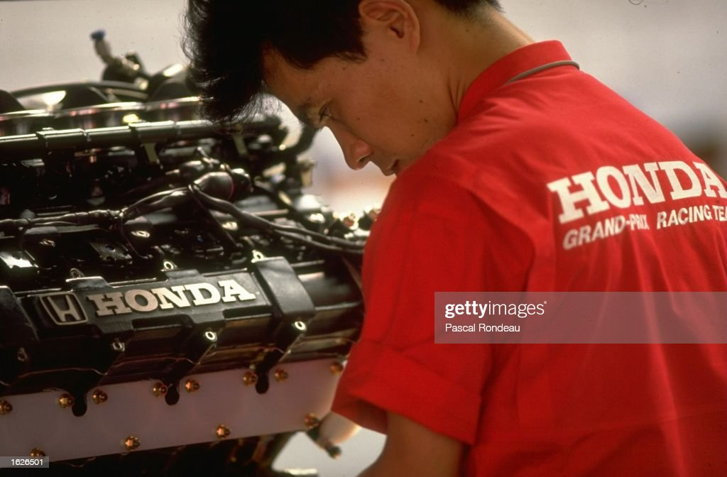 A mechanic works on a Honda engine in the McLaren pits before the West German Grand Prix at the Hockenheim circuit in West Germany. \ Mandatory Credit: Pascal Rondeau/Allsport