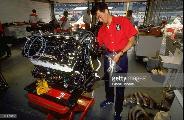 A mechanic works on a Honda Engine in the McLaren pits during the West German Grand Prix at the Hockenheim circuit in West Germany Mandatory Credit...