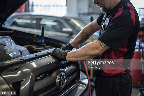 A mechanic works on a truck inside a Chevron Corp gas station in Albuquerque New Mexico US on Tuesday July 26 2016 Chevron is scheduled to release...