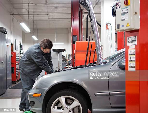 Mechanic works on auto