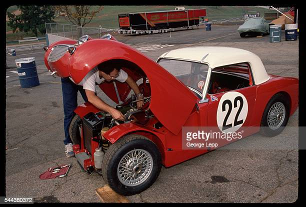 A mechanic works under the hood of a 1959 AustinHealey Sprite at the Road Atlanta Raceway in Georgia | Location Road Atlanta Georgia USA