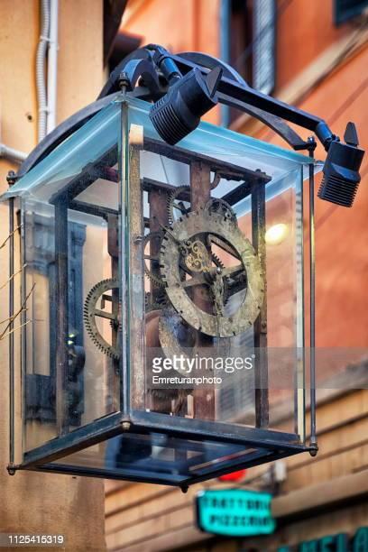 a mechanical clock with a glass casing at a hotel wall,bologna. - emreturanphoto bildbanksfoton och bilder