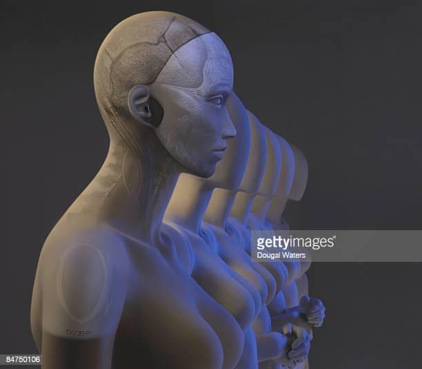 Mechanical clones standing in row.