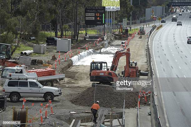 A mechanical digger operates on the side of a major highway in Melbourne Australia on Wednesday Aug 31 2016 Australia's gross domestic product...