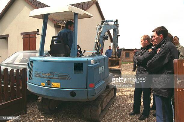 A mechanical digger will dig up the garden after two bodies were discovered on the premises