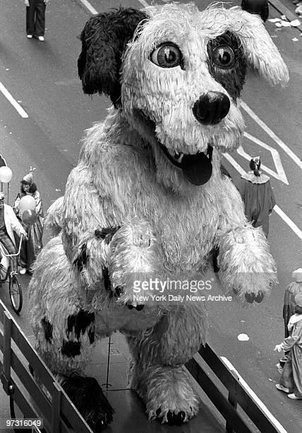 Mechanical dog that stands up on hind legs and begs has a gleam in his eye as truck carries him in Macy's Thanksgiving Day parade down Broadway