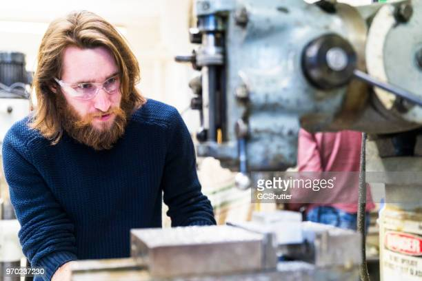 mechanical engineering student working at a science lab - mechanical engineering stock pictures, royalty-free photos & images