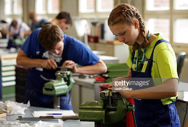 Mechanical engineering trainees learn the basics of precision filing at the Siemens training center on September 1 2010 in Berlin Germany...