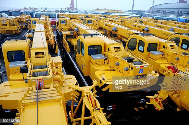 Mechanical equipment is gathered together for exporting at a container terminal on December 8 2015 in Lianyungang Jiangsu Province of China The...