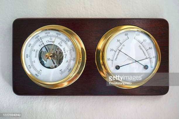 mechanical weather station mounted on a wooden plate. - emreturanphoto stock pictures, royalty-free photos & images