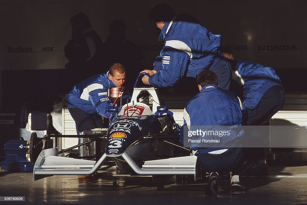 Mechanics and race engineers at work on the #3 Braun Tyrrell Honda Tyrrell-Honda 020 Honda RA101E during pre season testing 1st February 1991 at the Autodromo Enzo e Dino Ferrari in Imola, San Marino.