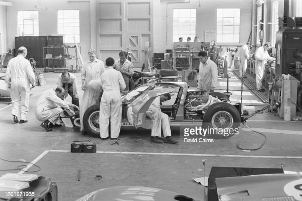 Mechanics assembling the Ford GT40 which the motor manufacturer will use to compete in the 24 Hours of Le Mans race at the company's facility in...