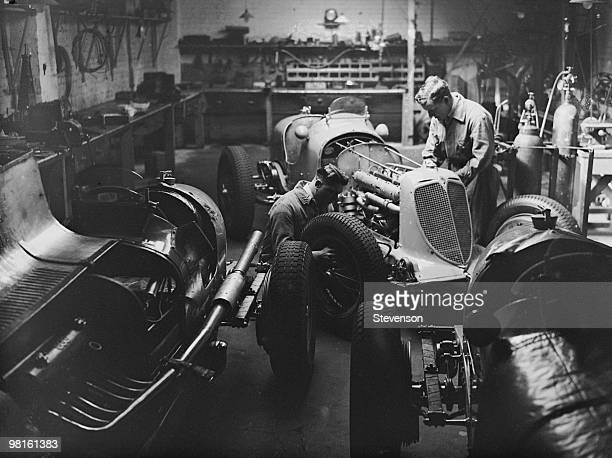 Mechanics at work on B Bira's racing car in his garage at Ravenscourt Park London 31st March 1938 Bira will be driving the car an ERA Ctype named...