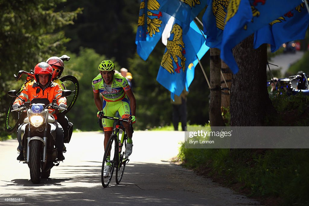 Mechanics carry spare bikes on motorbikes during the twentieth stage of the 2014 Giro d'Italia, a 167km high mountain stage between Maniago and Monte Zoncolan on May 31, 2014 in Monte Zoncolan, Italy.