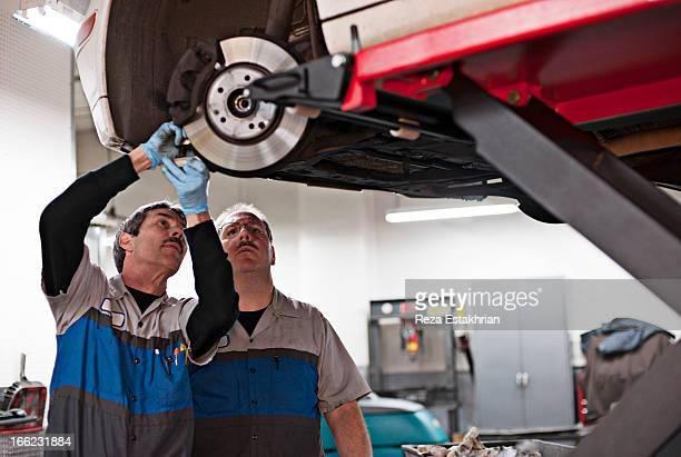 Mechanics check calibration on brakes