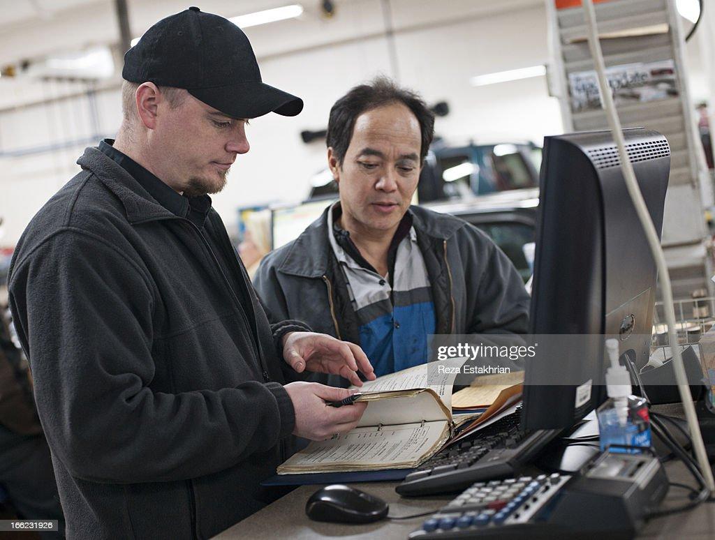Mechanics check service manual : Stock Photo