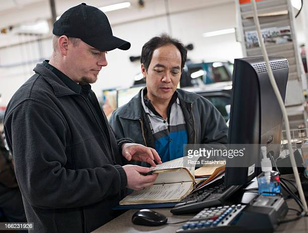mechanics check service manual - instruction manual stock photos and pictures