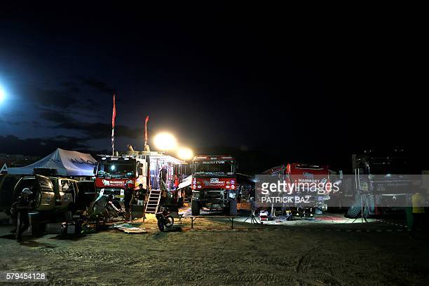 Mechanics fix Renault trucks in the bivouac of the Silkway rally near the town of Wuhai in Inner Mongolia on July 22 2016 One hundred thirty...