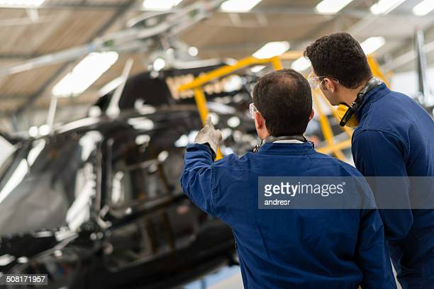 mechanics fixing a helicopter - inside helicopter stock pictures, royalty-free photos & images