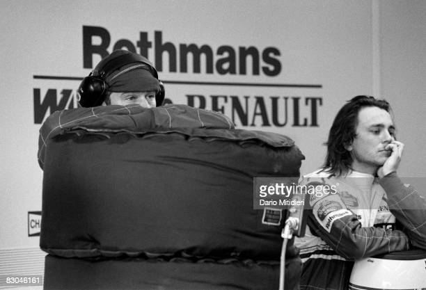 Mechanics from the Williams racing team wait for news about the condition of Formula 1 driver Ayrton Senna after his accident during the San Marino...
