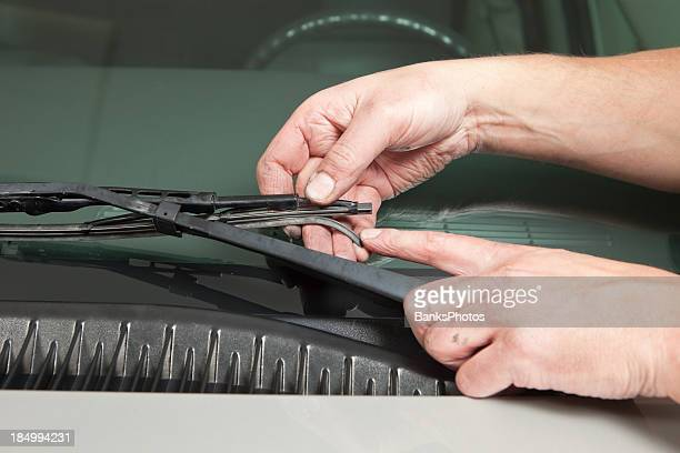 Mechanic's Hand Holding Broken Windshield Wiper Blade