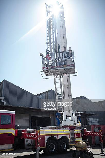 Mechanics maintaining fire engine