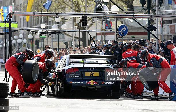 Mechanics of Audi change tyres at a pit stop of Mattias Ekstroem of Sweden during the presentation of the German Touring Car Championship DTM in...