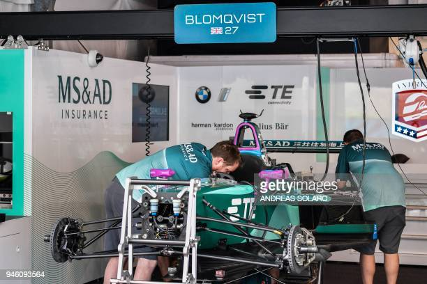 Mechanics of the MSAD Andretti team work on an electric race car in the pit before the start of the Rome leg of the Formula E electric car...