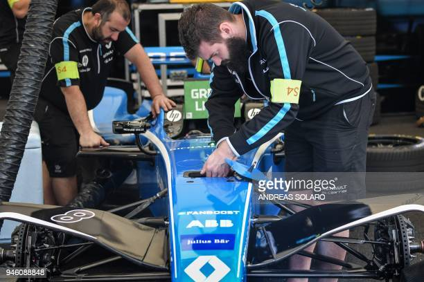 Mechanics of the Renault edams team work on an electric race car in the pit before the start of the Rome leg of the Formula E electric car...