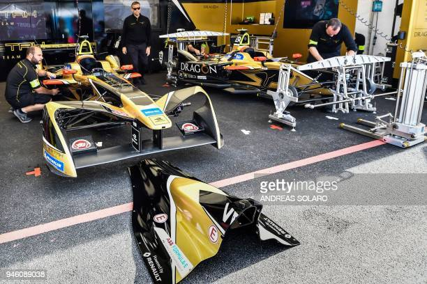 Mechanics of the Techeetah team work on an electric race car in the pit before the start of the Rome leg of the Formula E electric car championship...