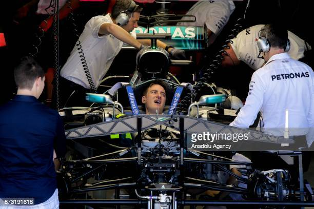 Mechanics prepares the F1 racing car of Lewis Hamilton of the Mercedes Team before the final race of F1 GP Brazil at the Jose Carlos Pace racetrack...