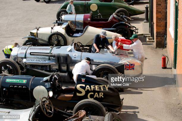 Mechanics refuelling the 24 Litre 1933 NapierRailton Endurance Record Track Racing Car linedup and on display outside The Clubhouse during The...