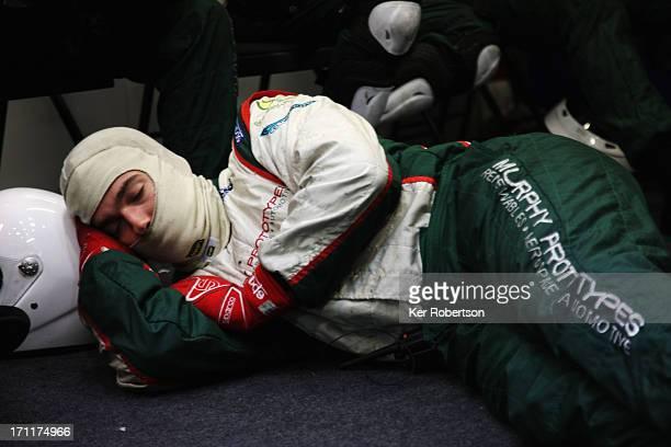 Mechanics rest in the Murphy Prototypes garage during the Le Mans 24 Hour race at the Circuit de la Sarthe on June 23 2013 in Le Mans France