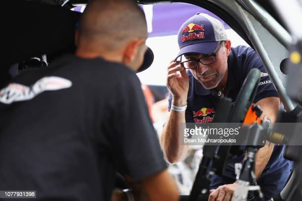 Mechanics speak to XRaid Mini JCW Team No 304 car driven by Stephane Peterhansel of France during the 2019 Dakar Rally Peru at Las Palmas air base or...