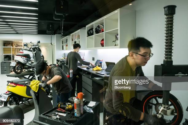 Mechanics work inside a Gogoro Inc workshop at one of the company's stores in Taipei Taiwan on Monday Jan 22 2018 Gogoro the Taiwanese...