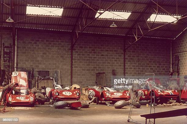 Mechanics work on race cars in the garage during the 1965 24 Hours of Le Mans which took place on June 1920 1965 in Le Mans France