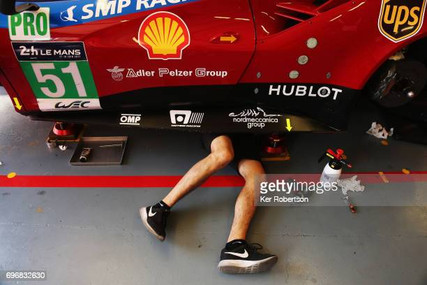 Mechanics work on the AF Corse Ferrari 488 of James Calado, Lucas di Grassi and Alessandro Pier Guidi before qualifying for the Le Mans 24 Hours race...