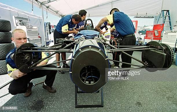 Mechanics work on the chassis of the MTCI team car driven by Takuya Kurosawa 26 May 2000 at Nazareth Speedway in Nazareth PA The Bosch Grand Prix...