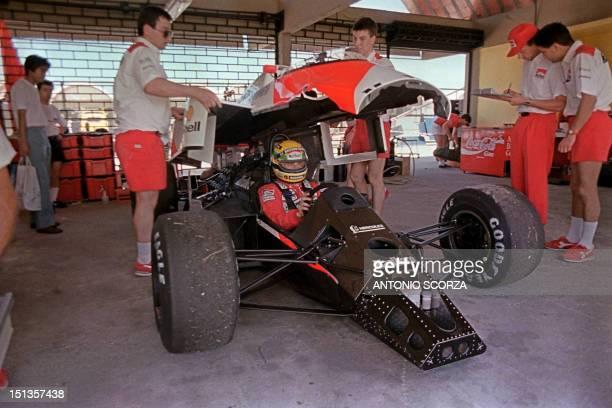 Mechanics working for Team McLaren remove the body from Brazilian Formula One champion Ayrton Senna's car during time trials in Rio de Janeiro Brazil...
