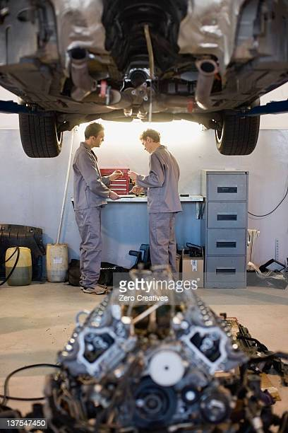 Mechanics working in garage