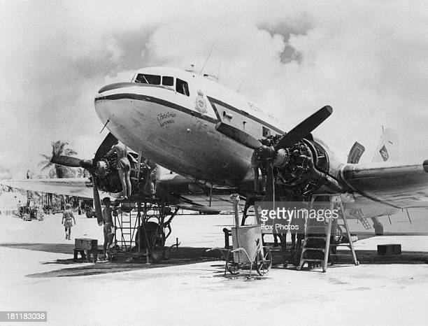 Mechanics working on a Douglas Dakota aircraft of the RAF Transport Command on Christmas Island in the Central Pacific Ocean during preparations for...